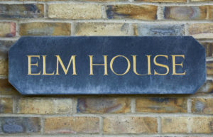elm house signage used on front of building