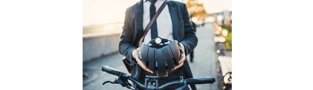 Man in suit chooses sustainable travel cycling to work