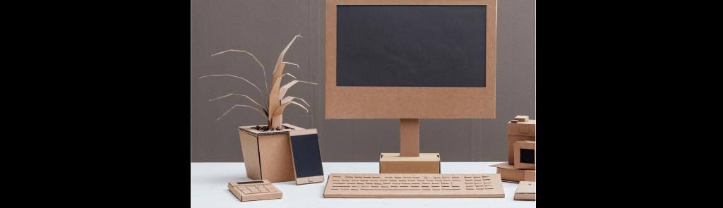 Cardboard desk set-up demonstrating reducing plastic in the office