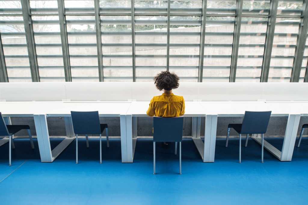 Business woman in office space considering office size