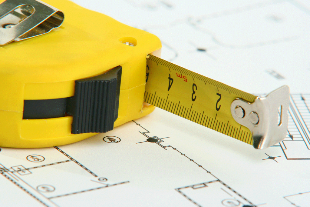 Tap measure and office size plans to calculate how much office space your business needs