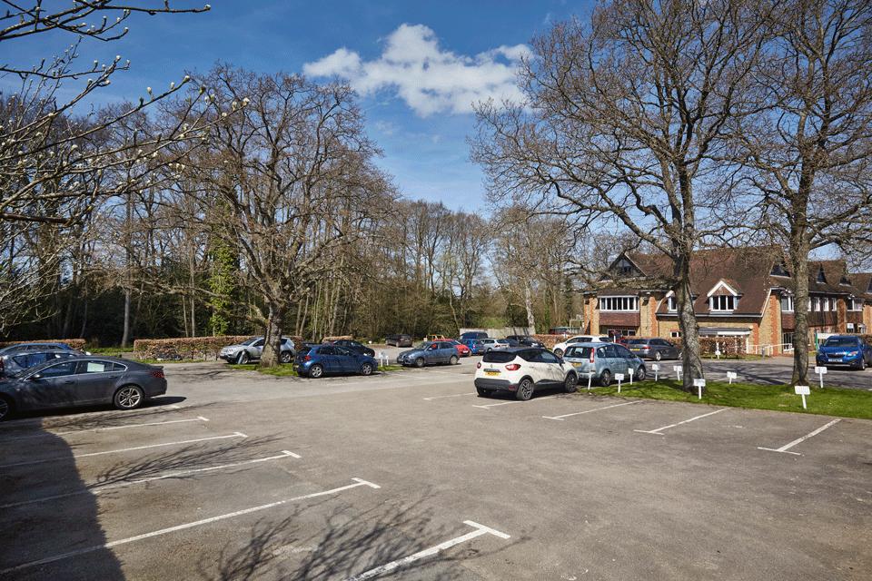 Tanshire Park Surrey Business Park - generous parking and scenic backdrop