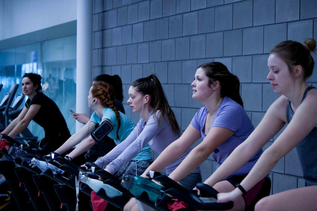 people working out in a gym on bikes