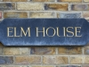 elm house sign on wall at tanshire park