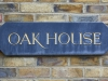 oak house sign on brick wall