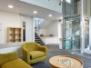 yellow sofas in bright office space